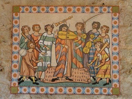 Trovadores y juglares cantando al amor cortés.